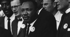 Source: https://en.wikipedia.org/wiki/Martin_Luther_King_Jr.#/media/File:Civil_Rights_March_on_Washington,_D.C._(Dr._Martin_Luther_King,_Jr._and_Mathew_Ahmann_in_a_crowd.)_-_NARA_-_542015_-_Restoration.jpg