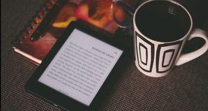 image of an reader and coffee mug